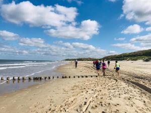 Hardlopers op strand